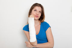 Woman with broken hand. In Bandage stock image