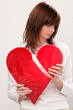Woman with broken heart. Portrait of young sad woman with broken heart stock photography