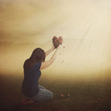 Woman with broken heart. Royalty Free Stock Photography