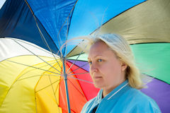 Woman with broken umbrella Royalty Free Stock Photography