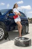 Woman with a broken wheel of her car Royalty Free Stock Image