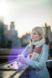 Woman on the Brooklyn Bridge Looking at Manhattan with a Coffee royalty free stock photo