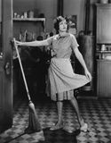 Woman with broom. (All persons depicted are no longer living and no estate exists. Supplier grants that there will be no model release issues Royalty Free Stock Images