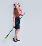 Woman with broom Stock Image