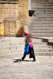 Woman with a broom in the Songzanlin Monastery,. Shangri-La, China - September 25, 2017: Woman with a broom in the Songzanlin Monastery, built in 1679, is the Royalty Free Stock Photo