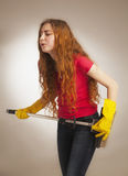 Woman with a broom styled rock guitarists (humorous photo) Royalty Free Stock Photo