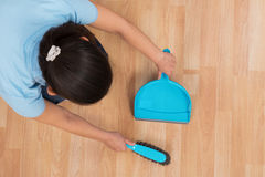 Woman Brooming Wooden Floor Stock Photography