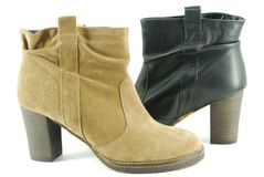 Woman brown and black boots Royalty Free Stock Photography