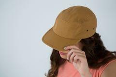 Woman in brown cap Royalty Free Stock Image