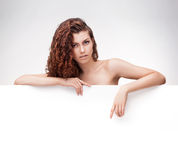 Woman with brown curly hair holding signboard Stock Photos