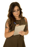 Woman in brown dress tattoos clipboard writing Stock Photography