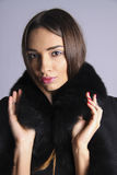 Woman with brown eyes  in Luxury Fur Coat Stock Photo