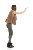 Woman In Brown Fur Waistcoat Writing, Side View Stock Photos