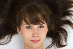Woman with brown hair. A portrait  of pretty young woman with tresses Royalty Free Stock Image