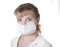 Woman with brown hair and a medical mask Royalty Free Stock Photography
