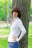 Woman with brown hair near tree. Photo of woman with brown hair near tree Royalty Free Stock Photography