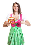Woman with brown hair recommending the bavarian pretzel Royalty Free Stock Photo