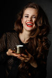 Woman with brown hair and red lips holding cup of coffee Royalty Free Stock Photo