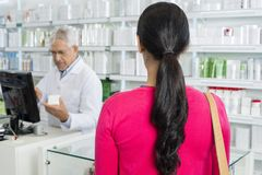 Woman With Brown Hair Standing In Pharmacy stock photos