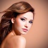Woman with brown hairs looking at camera. Portrait of beautiful pretty woman with brown hairs looking at camera stock photo