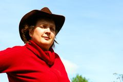 A woman in a brown hat Stock Images