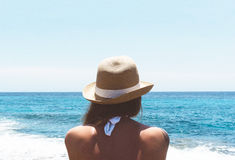 Woman in Brown Hat Facing Ocean Royalty Free Stock Photography