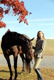 Woman with Brown Horse in Fall Royalty Free Stock Photography