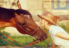 Woman and brown horse Royalty Free Stock Images