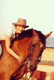 Woman on brown horse Royalty Free Stock Image