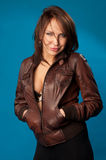 Woman in a brown jacket Stock Image
