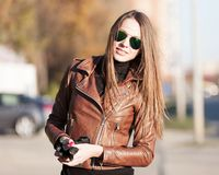 Woman, brown jacket, sunglasses. Close up royalty free stock photos