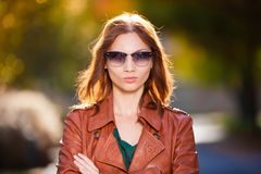Woman  brown  leather  coat Royalty Free Stock Image