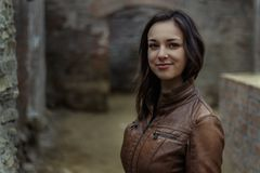 Woman in brown leather jacket Royalty Free Stock Images