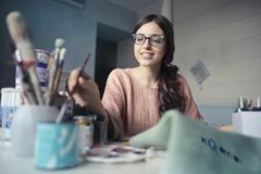 Woman in Brown Long-sleeved Shirt Wearing Eyeglasses Holding Paint Brush Stock Photography