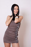Woman in brown mini dress Royalty Free Stock Image