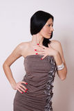 Woman in brown mini dress Stock Photography