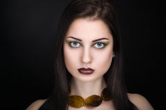Woman with brown necklace. Young beautiful woman lady model woman actress. Luxury bright stylish look. Chic impressive appearance. Perfect face smoky eyes makeup stock image