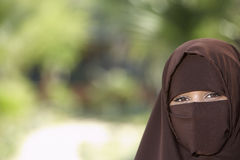 Woman In Brown Niqab Royalty Free Stock Photography