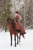 Woman in the brown riding habit. Keeps the Arab racer stock images