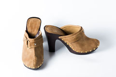 Woman brown shoes on white. Background Royalty Free Stock Photo