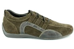 Woman brown sneaker shoe Royalty Free Stock Photos