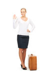 Woman with brown suitcase Stock Photo