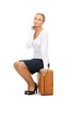 Woman with brown suitcase Stock Image