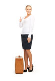 Woman with brown suitcase Royalty Free Stock Photography