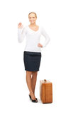 Woman with brown suitcase Stock Images