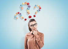 Woman in brown and three questions Royalty Free Stock Images