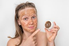 Woman with brown volcanic mask on her face. Spa and beauty concept royalty free stock images
