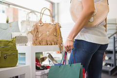 Woman browsing bags Stock Photography