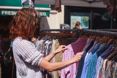 Woman browsing clothes at market Royalty Free Stock Photos