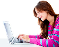 Woman browsing on her computer Stock Images